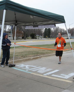 Our Overal Male Race Winner crossing the finish line